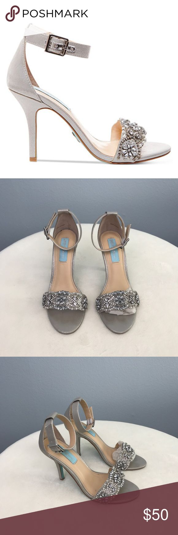 Juno silver rhinestone pearl strapped heels sandal See pics for details. Worn once for a few hours at a wedding.  Still sold at Macy's for $130 plus!  I have the box but will be shipped without to keep shipping cost down.  Will be shipped with replacement heel caps.  3 3/4' heel  Ball 3'  Length wall to toe 9' Betsey Johnson Shoes Heels