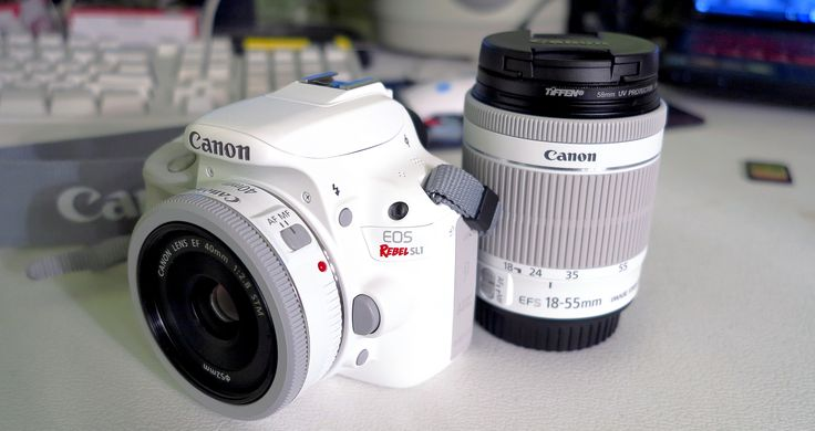 "White Canon Rebel SL1 mounting a white Canon 40mm ""pancake"" lens, adjacent the white Canon 18-55mm ""kit"" lens.  http://ehowton.livejournal.com/tag/camera"