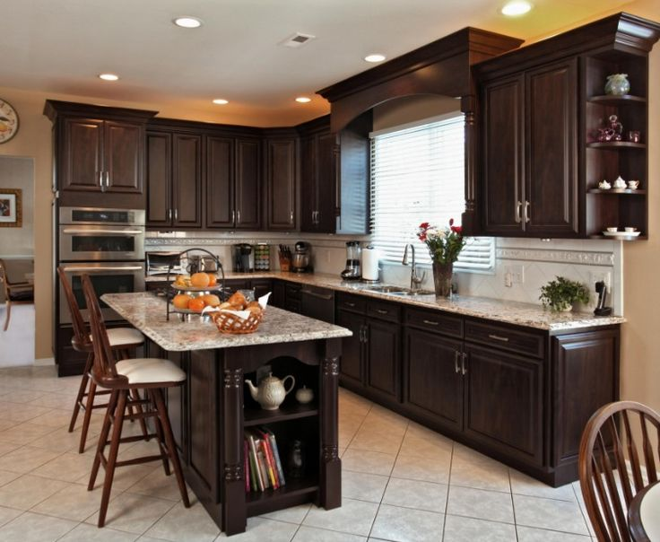 Love this budget kitchen remodel with refaced dark cabinets