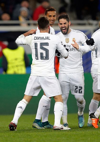 The players of Real Madrid celebrate Carvajal after scoring during the UEFA Champions League Group A match between FC Shakhtar Donetsk and Real Madrid CF at...