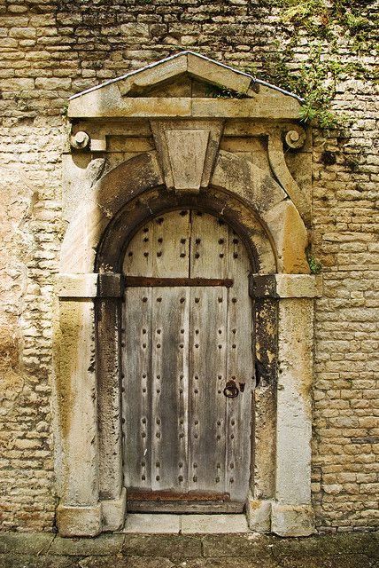 An ancient oak door in an Elizabethan mansion
