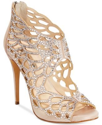 Radiating cutouts create a butterfly effect encrusted in rhinestones for an amazingly elegant evening look in Inc International Concepts' Sarane sandals. | Fabric upper; manmade sole | Imported | Roun