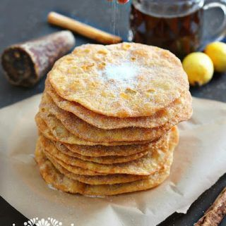 Mexican Buñuelos - These light, crispy, and sweet round disc are sprinkled with sugar or bathed in piloncillo syrup.