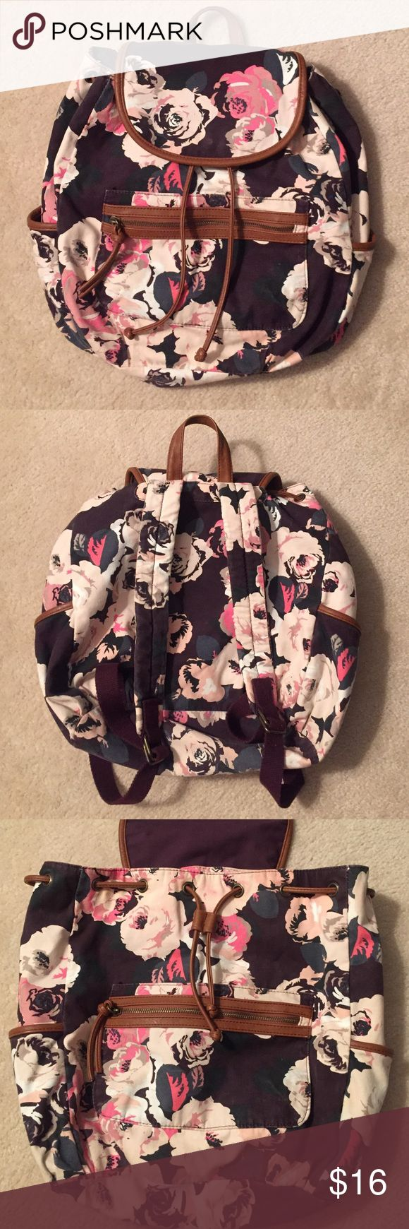 American Eagle✨Roses Canvas Backpack Beautiful pink and cream roses on brownish burgundy background. Two outer pockets on each side and one zipper compartment in front. Clean inside. Good condition. See pic 4 for slight discoloration on inside flap. American Eagle Outfitters Bags Backpacks