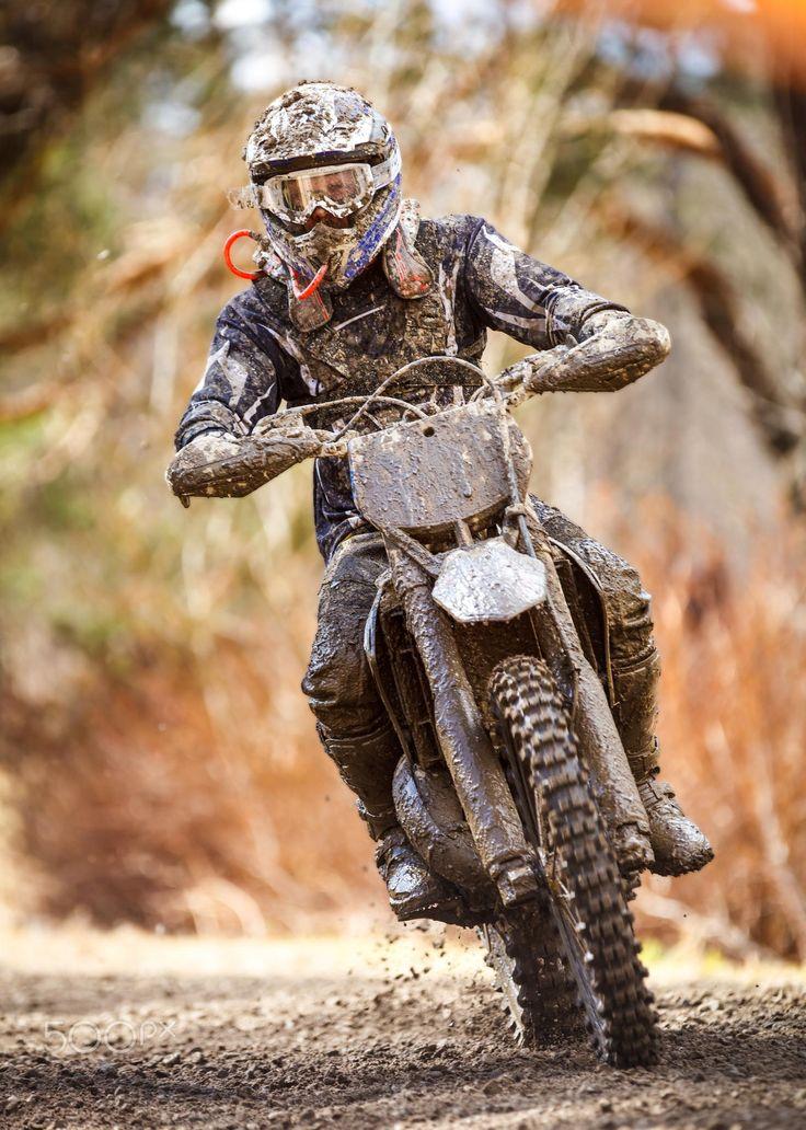 Motocross Racer - Motocross racer on wet and muddy terrain in Parola, Finland.
