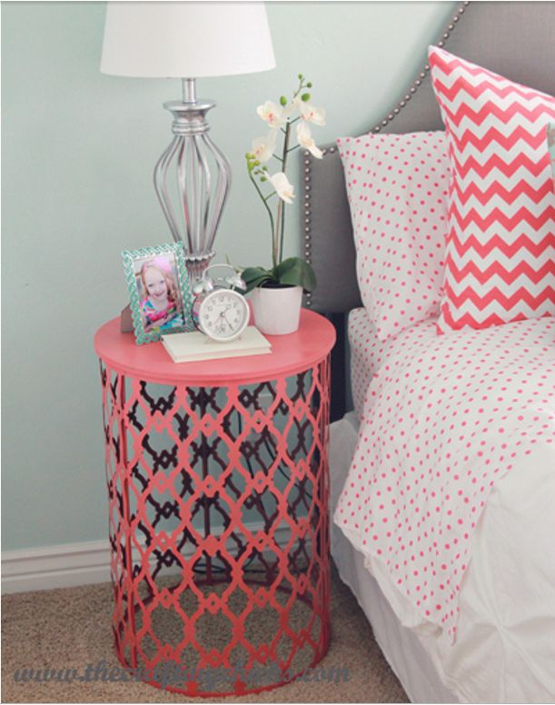 Spray paint cheap metal garbage cans and turn them upside-down to use as cute night-stands