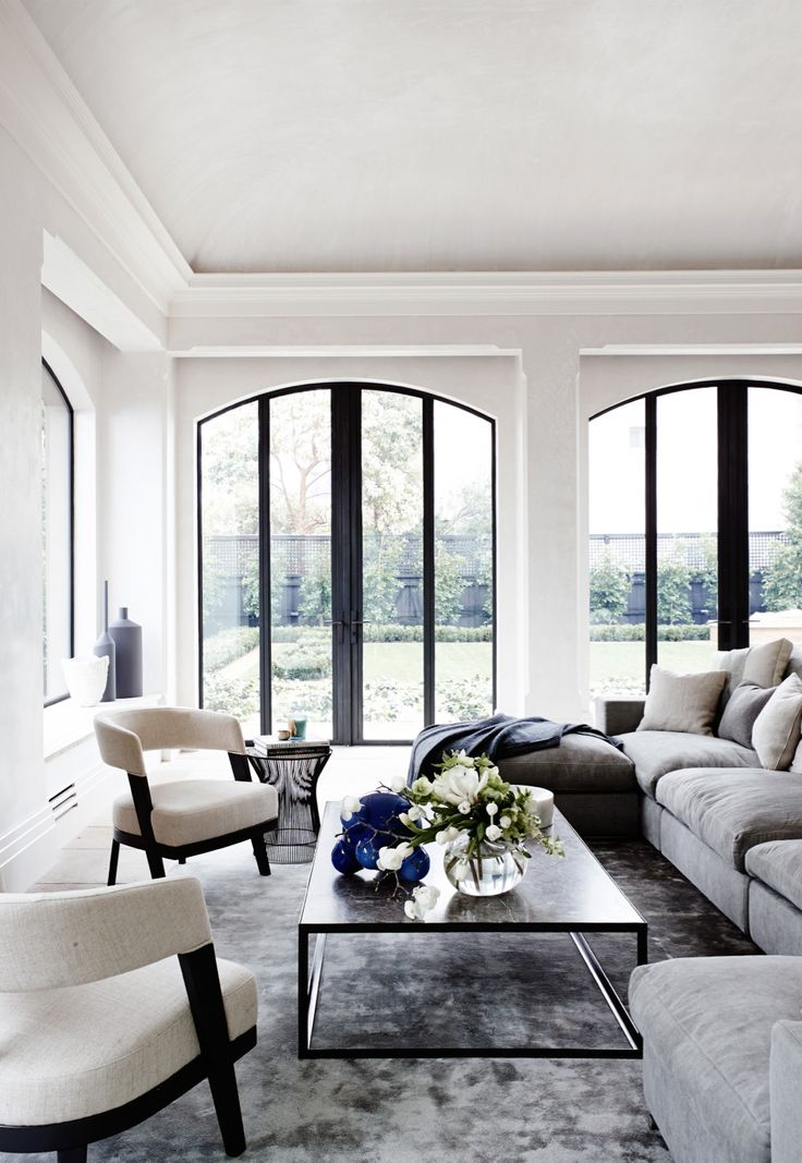 This living room in Melbourne's South Yarra is elegant, stylish, and sophisticated with it's 1930's structure, black framed French doors and neutral furnishings.