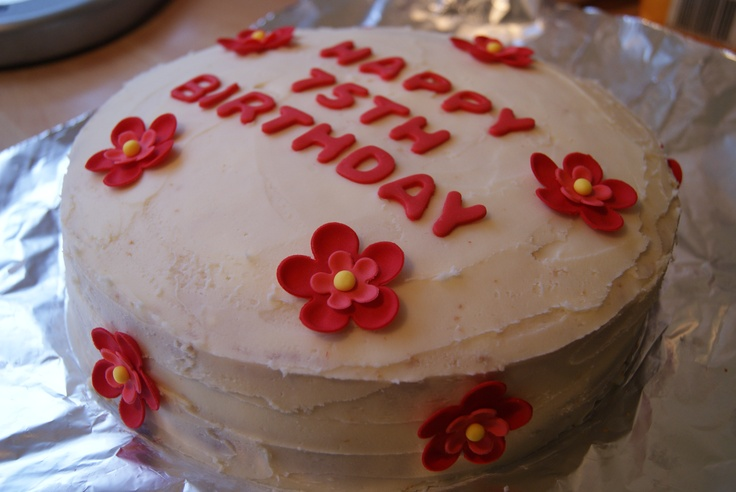 Another one of £15 cakes, this time a victoria sponge cake, buttercream frosting and red flowers and letters