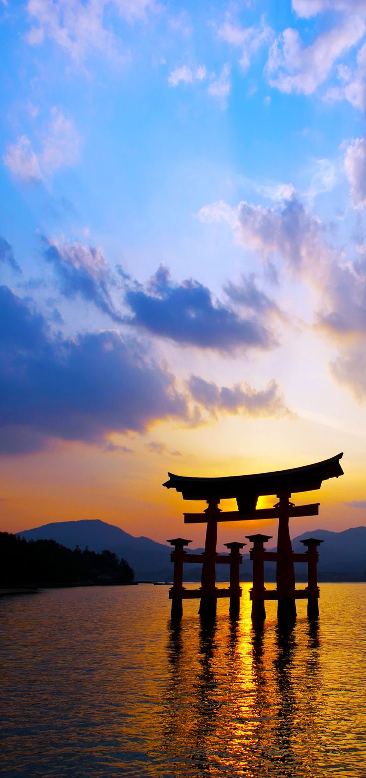 Itsukushima Shrine with Miyajima Torii silhouette at dusk.   |  19 Reasons to Love Japan, an Unforgettable Travel Destination