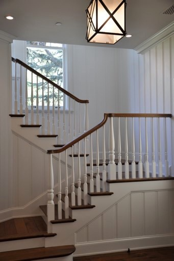 white + window provides natural light to stairway.