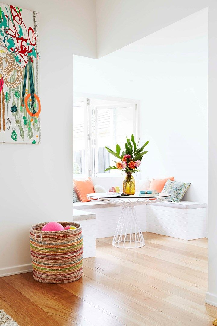 A cosy eating nook with colourful artwork | Home Beautiful Magazine Australia