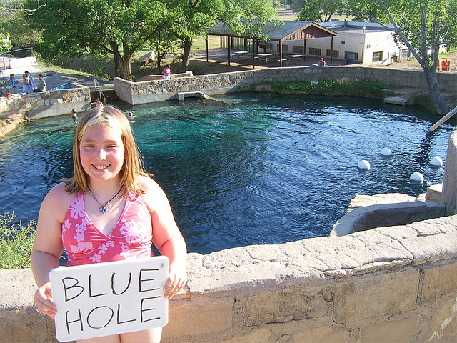 The Blue Hole in Santa Rosa, New Mexico. I don't know who she is, but I have been here. Pretty cool. Goes down like 80ft. and people scuba dive.
