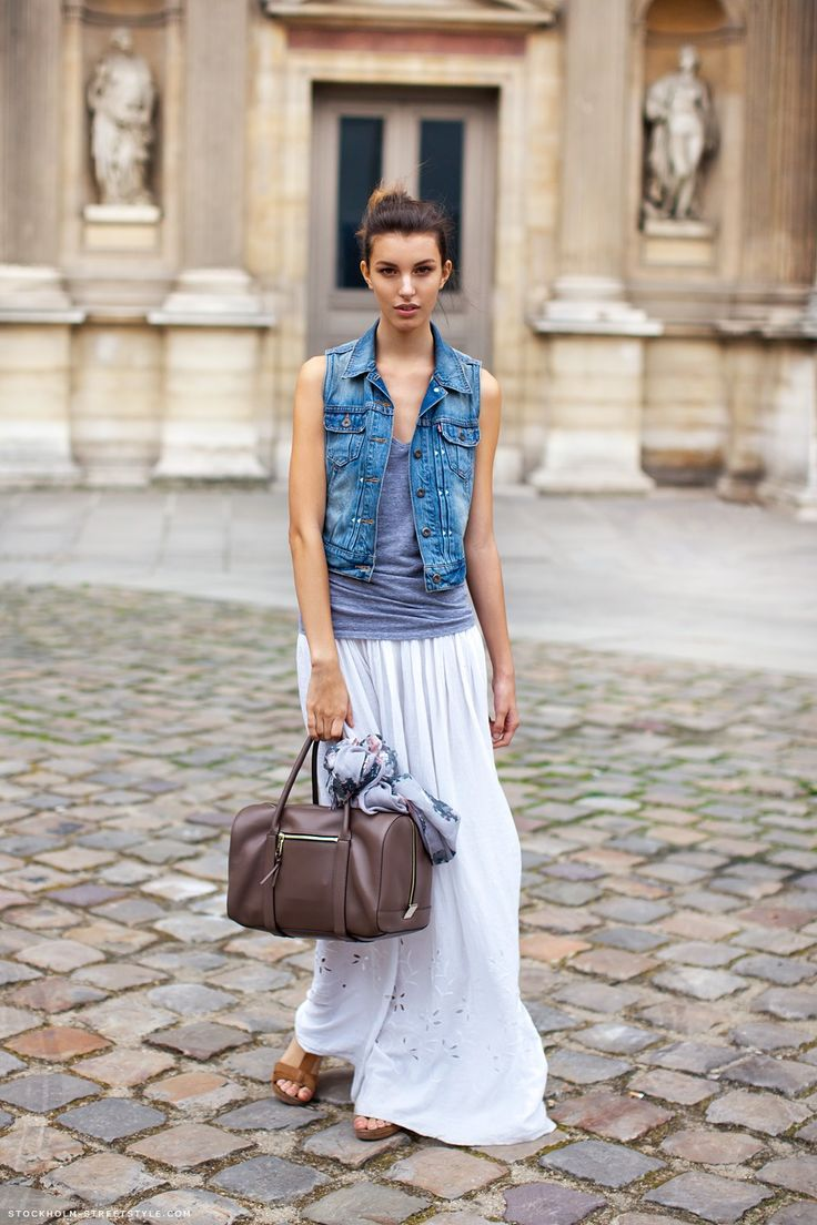 I love the way she wears the denim vest with a floor length skirt.