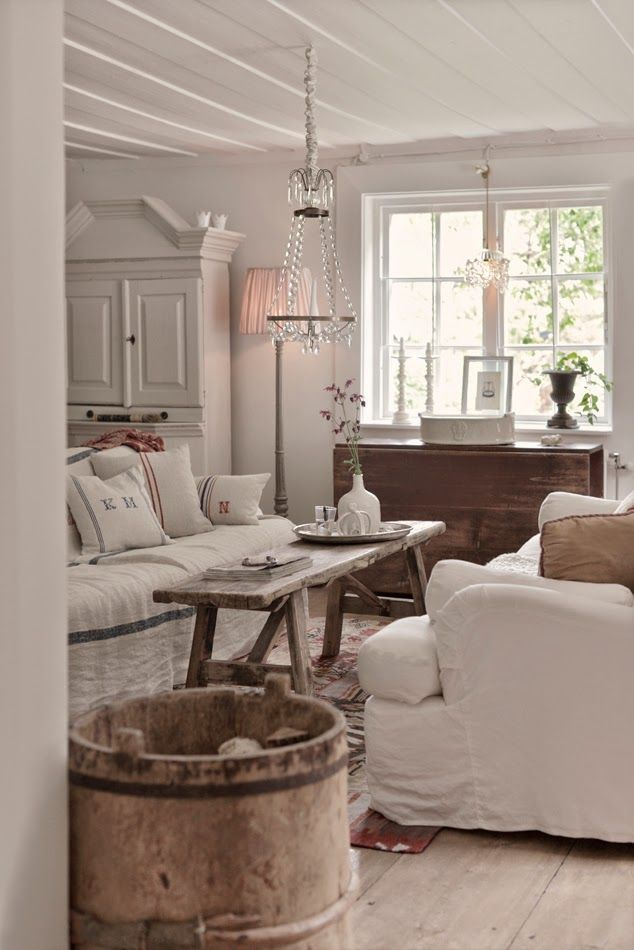 The all white look combined with rough finish wood. Elegant and Rustic home decor