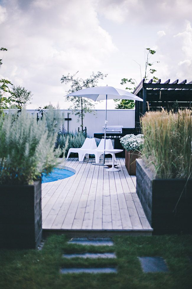 Decked garden with a pool