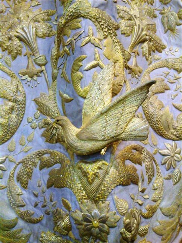 This gorgeous three dimensional dove was embroidered in gold and silver thread. This piece is part of a larger piece of ecclesiastical (church) embroidery.    This image was found on Pinterest, but without a link back to people who created it. So, if you have any information that could link back to the maker, please let us know.  It's likely the work of Sebastien Marchante.