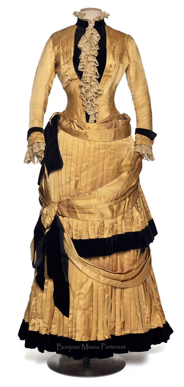 Dress in 2 pieces, Chauvet, ca. 1884–86. Yellow silk taffeta with black trim and lace. Photo: Jean Tholance. Les Arts Décoratifs via Europeana Fashion