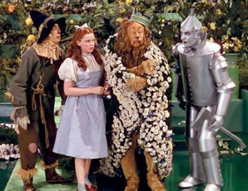 """*THE WIZARD of OZ, 1939... The Scarecrow (Ray Bolger), Dorothy (Judy Garland) and the Tin Man (Jack Haley) listen to the Cowardly Lion (Bert Lahr) sing """"If I Were King of the Forest"""" in a scene from the digitally remastered 70th anniversary edition of """"The Wizard of Oz,"""" which forever associated the movie with Kansas."""