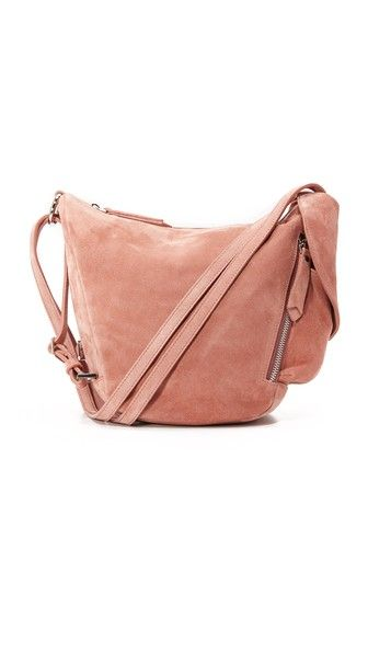 A slouchy MANU Atelier shoulder bag with an asymmetrical silhouette, rendered in soft suede. Zip front pocket and flap side pocket. Top zip and lined interior. Double shoulder straps. Dust bag included.