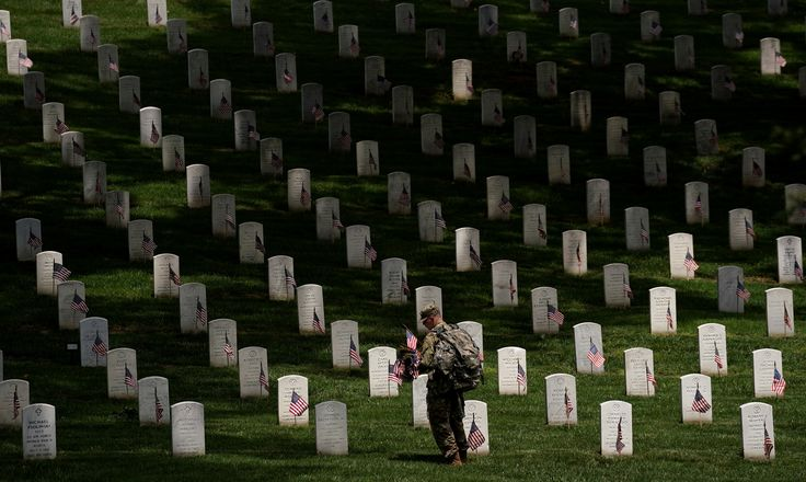 A soldier from the 3rd U.S. Infantry Regiment (Old Guard) takes part in 'Flags-in', where a flag is placed at each of the 284,000 headstones at Arlington National Cemetery ahead of Memorial Day, in Arlington, Virginia, U.S., May 25, 2017. REUTERS/Kevin Lamarque     TPX IMAGES OF THE DAY via @AOL_Lifestyle Read more: https://www.aol.com/article/news/2017/05/25/us-soldiers-plant-thousands-of-flags-at-cemetery-in-memorial-day/22110184/?a_dgi=aolshare_pinterest#fullscreen