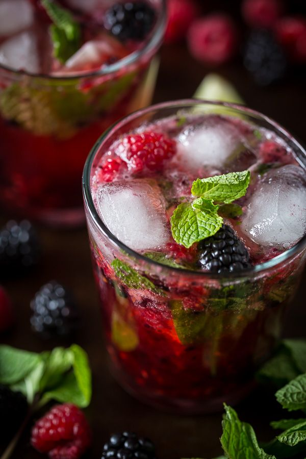 This mixed berry mojito cocktail combines delicious fresh raspberries, blackberries, mint and rum. It's super delicious, perfect for spring and takes only 5 minutes to make!