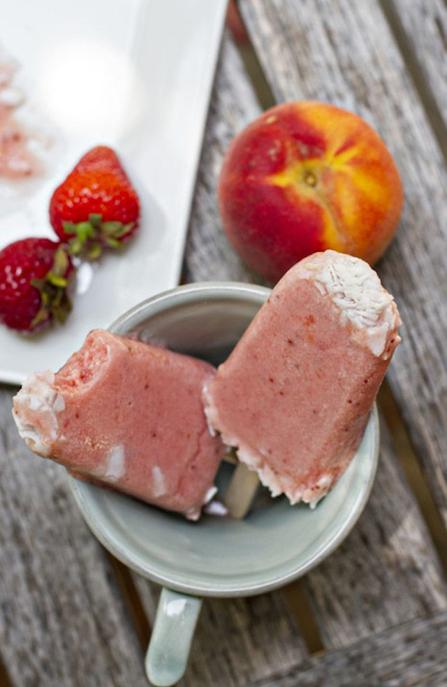 Use strawberries, peaches and coconut milk to make these popsicles.