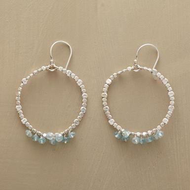 Handmade in Hawaii, sterling silver beads dance like drops of sea spray around…
