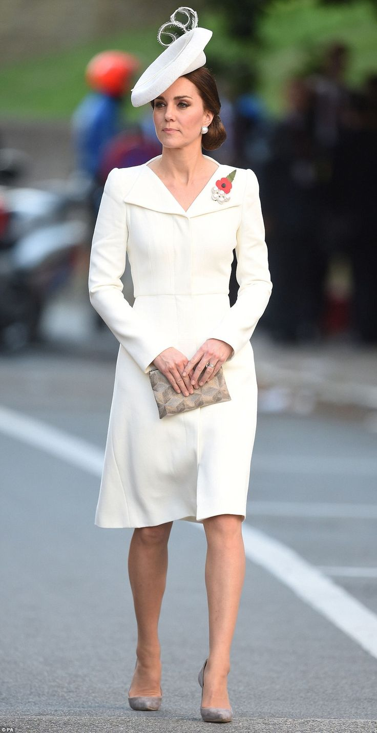 The Duchess of Cambridge arrived wearing a white Alexander McQueen coat-dress, and wore a ...