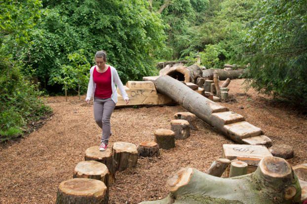 Woman Walking Along A Log At The Log Trail Juegos Para