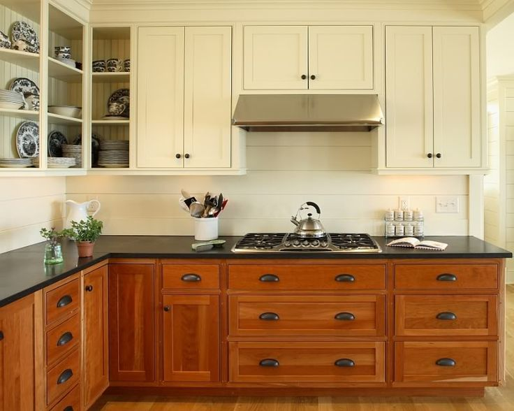 White upper cabinets with wood lowers white subway tile for Kitchen cabinets upper