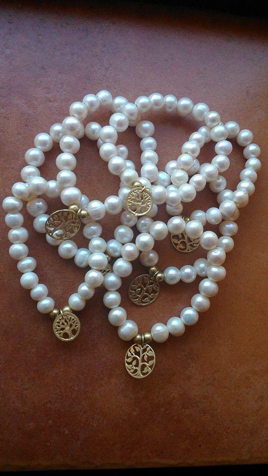Pulseras elásticas de perlas naturales y colgante de plata 925m.