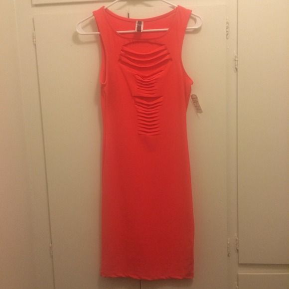 Neon pink dress Beautiful neon pink dress. Open center. New with tags. Dresses