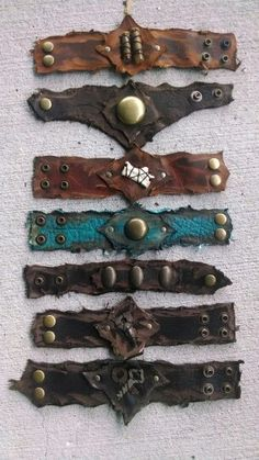 Bracelets made from recycled leather scraps, solid brass hardware, and found objects.