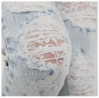 Lace under holes in jeans.