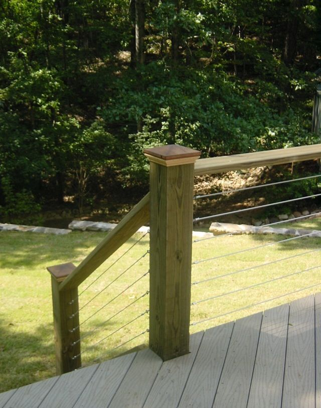 Deck railing.  Wire tension tightened between the posts. rustic with wire actually looks good