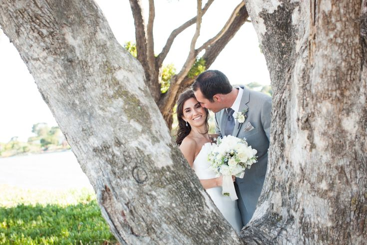 We love this peek-a-boo shot through the trees. The love in this shot is amazing. Plan you wedding at The Clubhouse at Peacock Gap! http://www.peacockgapclubhouse.com/weddings
