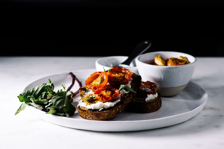 Fancy up your toast with goat cheese, reduced balsamic and roasted tomatoes.