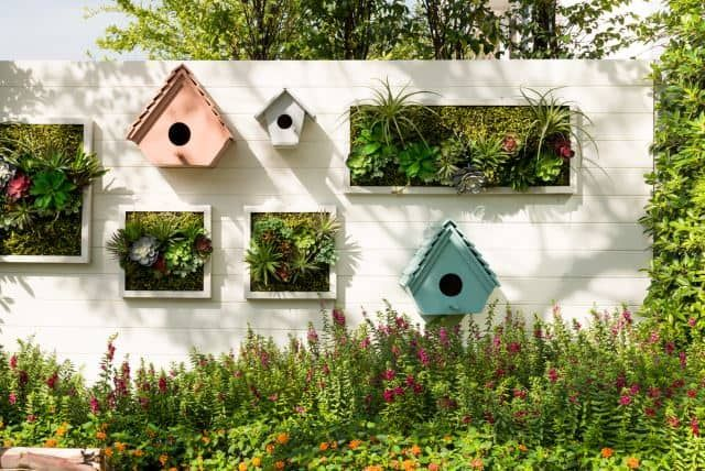 This wall garden features squares of garden space. Vertical gardens means you can basically have a suspended garden in any sort of capacity you'd like. In this case, this garden is neatly packed into a wall space to add charm to any outdoor space. You can easily switch out the plants to match different holidays to add some extra interesting garden décor.