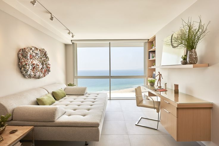 A creative space with a custom sofa in wool felt and side tables made of maple.