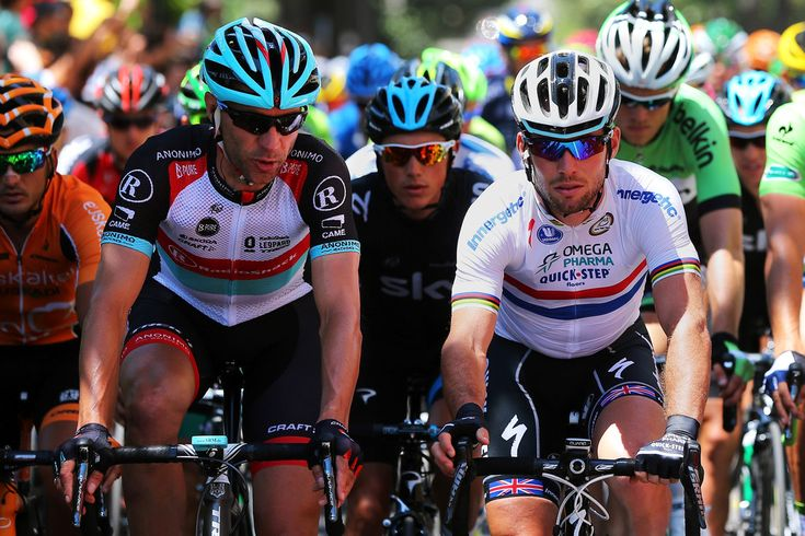 Jens Voigt (L) of Germany and Radioshack Leopard chats to Mark Cavendish of Great Britain and Omega Pharma-Quick Step at the start of stage three of the 2013 Tour de France,