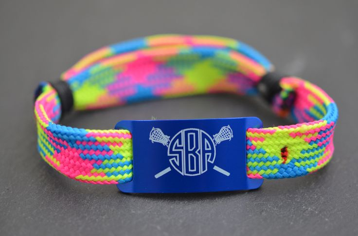 Look at this awesome NEW lacrosse shooting string bracelet design we have come up with! Makes an awesome personalized lacrosse gift for lax girls. This bracelet features our blue, green, & pink argyle bracelet with a blue slider. #monogram #girlslacrosse