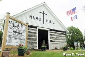 Mars Hill Church Just southeast of Ottumwa is the oldest log cabin church west of the Mississippi River; they have an annual meeting in June...