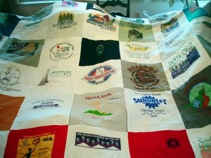 Make a t-shirt quilt!  If you have the extra funds and want to hang on to those shirts, consider doing something practical with them if you know you aren't going to wear them.  Send them off to have a quilt made of your race t-shirts!  There are lots of companies that can do this for you, but of the ones I have seen in person, I think Campus Quilt Co. and Too Cool T-Shirt Quilts do the best job. My host could never have too many cozy blankets!