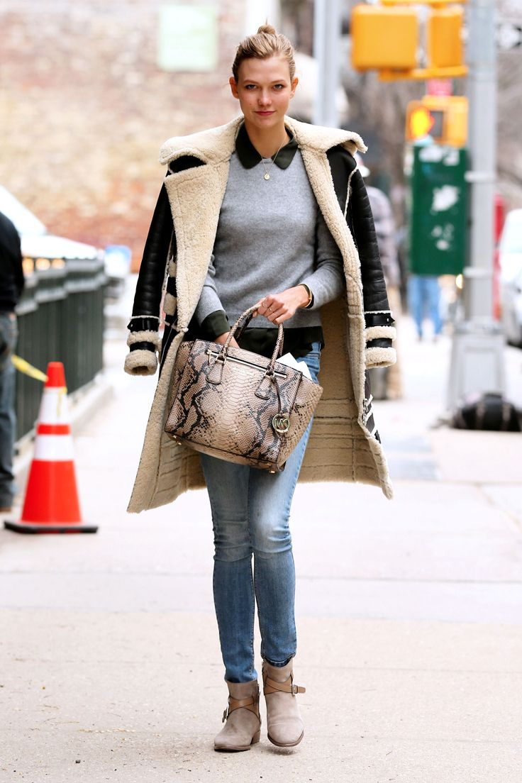 Model Karlie Kloss carrying a Michael Kors handbag. March 2014