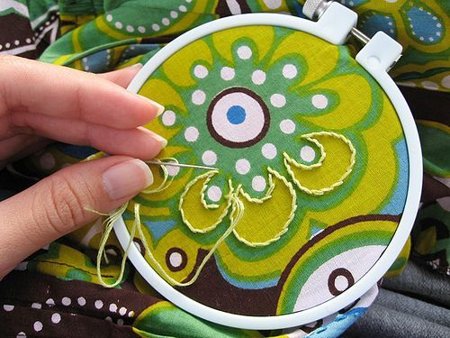 This is such an interesting idea - outlining a fabric pattern with stitching.: