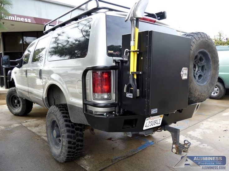 Aluminum Off Road Rear Bumper, Roof Rack, and Expedition Kit on a Ford Excursion.