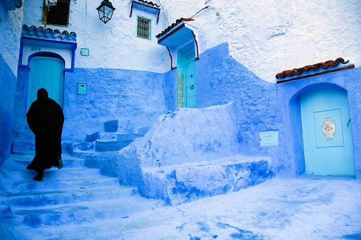 Traditional blue-painted doors and walls in Chefchaouen's old town. Image by David Sutherland / Photographer's Choice / Getty Images.
