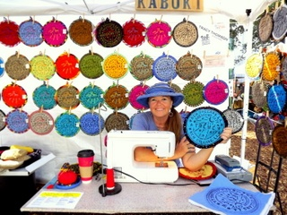 my friend Tracy Thompson and her new orleans pot holders  hand made each of them from scratch.  she also is the maker of Kabuki hats..and can be found in the quarter most days at the artist co op on charters or at a festival on the weekend...if she's not in NY doing the same thing up there...