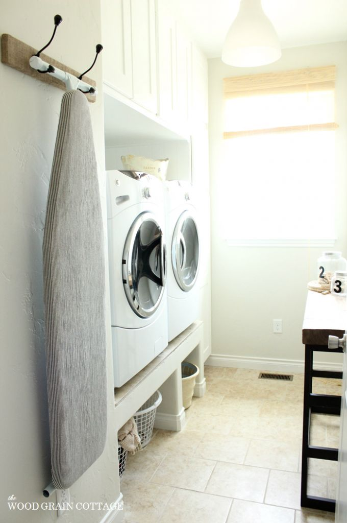 DIY Laundry Room Crates--before crates, with baskets. I just wonder if this wooden platform would be stable enough to prevent washer vibration.