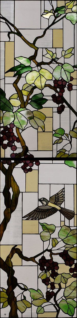 Birds and grapes in stained glass.